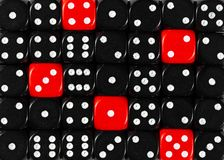 Background of random ordered black dices with five red cubes. Pattern background of random ordered black dices with five red cubes royalty free stock image