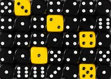 Background of random ordered black dices with five yellow cubes. Pattern background of random ordered black dices with five yellow cubes royalty free stock photos