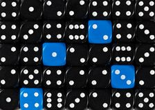 Background of random ordered black dices with four blue cubes. Pattern background of random ordered black dices with four blue cubes royalty free stock image