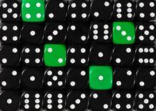 Background of random ordered black dices with four green cubes. Pattern background of random ordered black dices with four green cubes stock photography