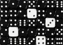 Background of random ordered black dices with four white cubes stock images
