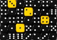 Background of random ordered black dices with four yellow cubes. Pattern background of random ordered black dices with four yellow cubes stock photography