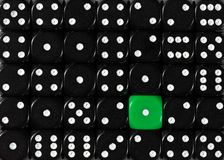 Background of random ordered black dices with one green cube. Pattern background of random ordered black dices with one green cube royalty free stock images