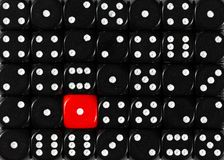 Background of random ordered black dices with one red cube. Pattern background of random ordered black dices with one red cube royalty free stock photography