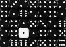 Background of random ordered black dices with one white cube. Pattern background of random ordered black dices with one white cube stock photo