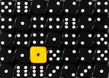 Background of random ordered black dices with one yellow cube. Pattern background of random ordered black dices with one yellow cube royalty free stock images