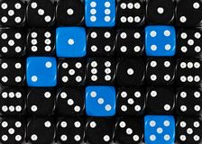 Background of random ordered black dices with six blue cubes. Pattern background of random ordered black dices with six blue cubes stock photos