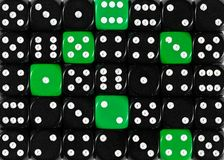 Background of random ordered black dices with six green cubes. Pattern background of random ordered black dices with six green cubes royalty free stock photos