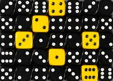 Background of random ordered black dices with six yellow cubes. Pattern background of random ordered black dices with six yellow cubes stock images