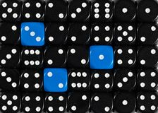 Background of random ordered black dices with three blue cubes. Pattern background of random ordered black dices with three blue cubes stock image