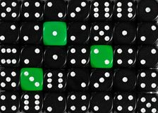 Background of random ordered black dices with three green cubes. Pattern background of random ordered black dices with three green cubes royalty free stock image