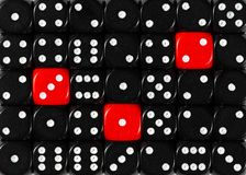 Background of random ordered black dices with three red cubes. Pattern background of random ordered black dices with three red cubes stock image