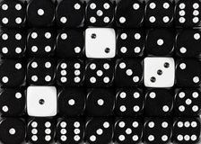 Background of random ordered black dices with three white cubes. Pattern background of random ordered black dices with three white cubes royalty free stock images
