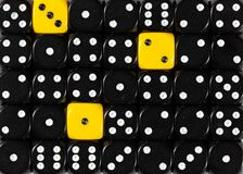 Background of random ordered black dices with three yellow cubes. Pattern background of random ordered black dices with three yellow cubes royalty free stock images