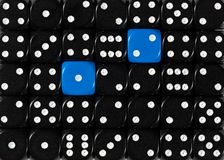 Background of random ordered black dices with two blue cubes. Pattern background of random ordered black dices with two blue cubes royalty free stock image