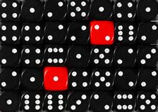 Background of random ordered black dices with two red cubes. Pattern background of random ordered black dices with two red cubes royalty free stock photography