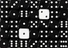Background of random ordered black dices with two white cubes. Pattern background of random ordered black dices with two white cubes stock images