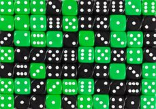Background of 70 random ordered black and green dices. YellowPattern background of 70 random ordered black and green dices stock images