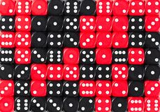 Background of 70 random ordered black and red dices. Pattern background of 70 random ordered black and red dices royalty free stock images