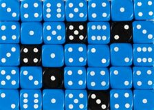 Background of random ordered blue dices with five black cubes. Pattern background of random ordered blue dices with five black cubes stock photo