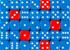 Background of random ordered blue dices with five red cubes. Pattern background of random ordered blue dices with five red cubes royalty free stock image