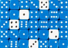Background of random ordered blue dices with five white cubes. Pattern background of random ordered blue dices with five white cubes royalty free stock images