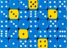 Background of random ordered blue dices with five yellow cubes. Pattern background of random ordered blue dices with five yellow cubes stock photo