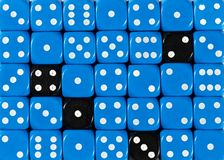 Background of random ordered blue dices with four black cubes. Pattern background of random ordered blue dices with four black cubes royalty free stock images