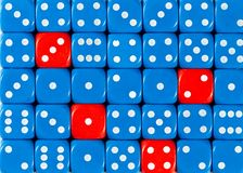 Background of random ordered blue dices with four red cubes. Pattern background of random ordered blue dices with four red cubes stock photo