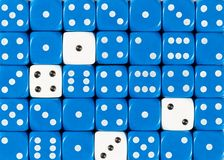 Background of random ordered blue dices with four white cubes stock image