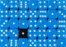 Background of random ordered blue dices with one black cube. Pattern background of random ordered blue dices with one black cube royalty free stock photos