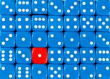 Background of random ordered blue dices with one red cube. Pattern background of random ordered blue dices with one red cube stock images