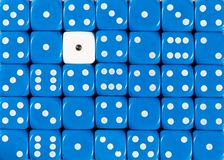 Background of random ordered blue dices with one white cube. Pattern background of random ordered blue dices with one white cube stock photo