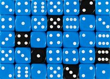 Background of random ordered blue dices with six black cubes. Pattern background of random ordered blue dices with six black cubes royalty free stock photography