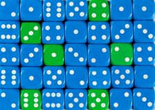 Background of random ordered blue dices with six green cubes. Pattern background of random ordered blue dices with six green cubes royalty free stock image
