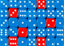 Background of random ordered blue dices with six red cubes. Pattern background of random ordered blue dices with six red cubes stock photography