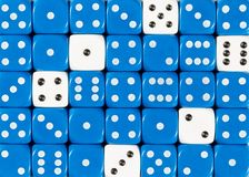 Background of random ordered blue dices with six white cubes. Pattern background of random ordered blue dices with six white cubes royalty free stock image