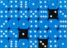 Background of random ordered blue dices with three black cubes. Pattern background of random ordered blue dices with three black cubes stock image