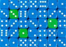 Background of random ordered blue dices with three green cubes. Pattern background of random ordered blue dices with three green cubes stock photography