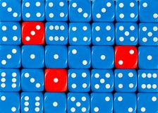 Background of random ordered blue dices with three red cubes. Pattern background of random ordered blue dices with three red cubes royalty free stock images