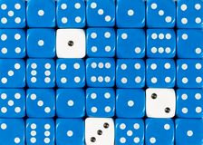 Background of random ordered blue dices with three white cubes. Pattern background of random ordered blue dices with three white cubes royalty free stock images