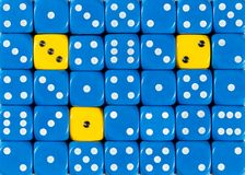 Background of random ordered blue dices with three yellow cubes. Pattern background of random ordered blue dices with three yellow cubes stock image
