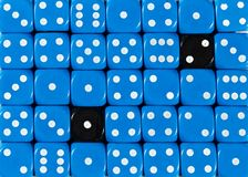 Background of random ordered blue dices with two black cubes. Pattern background of random ordered blue dices with two black cubes stock photos