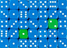 Background of random ordered blue dices with two green cubes. Pattern background of random ordered blue dices with two green cubes royalty free stock images