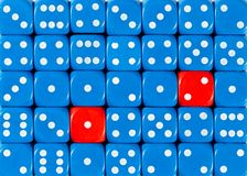 Background of random ordered blue dices with two red cubes. Pattern background of random ordered blue dices with two red cubes royalty free stock image