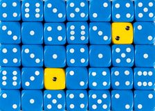Background of random ordered blue dices with two yellow cubes. Pattern background of random ordered blue dices with two yellow cubes royalty free stock image