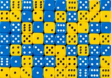 Background of 70 random ordered blue and yellow dices. Pattern background of 70 random ordered blue and yellow dices stock photos