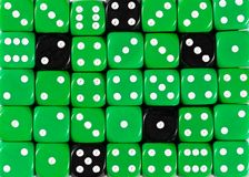 Background of random ordered green dices with five black cubes. Pattern background of random ordered green dices with five black cubes royalty free stock image