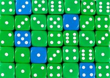 Background of random ordered green dices with five blue cubes. Pattern background of random ordered green dices with five blue cubes royalty free stock photos