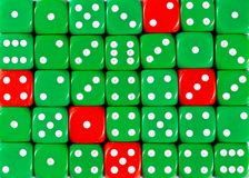 Background of random ordered green dices with five red cubes. Pattern background of random ordered green dices with five red cubes royalty free stock images